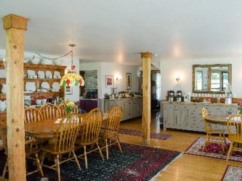 Enjoy breakfast in our spacious dining room. This is a great gathering space for guests.