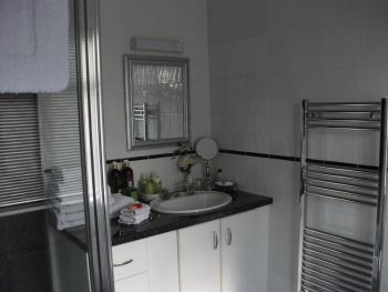The Amber Room Ensuite with double shower, luxury toiletries and newly fitted heated towel rail