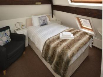Room 5 - single/small Double beamed attic room with velux window 3/4 bed.
