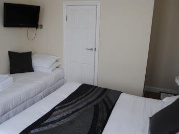 King Bed en-suite bedroom Extra Single Bed in Image Available Upon Request at Extra Charge